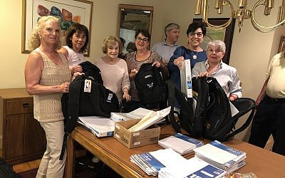 Volunteers preparing backpacks are Nancy Friedberg, Rina Wolfe, Eleanor Sims, Susan Sandler, Laurence Rosenthal, Sheila Adelman and Miriam Strickman Levitas.