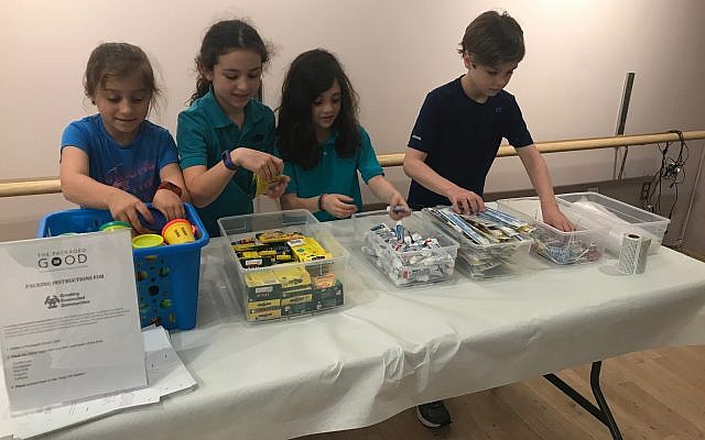 Children participate in a community service project with The Packaged Good.