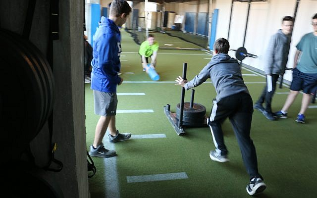 Students in the strength and conditioning class, the first step in the Sports Science Academy's honors diploma program.
