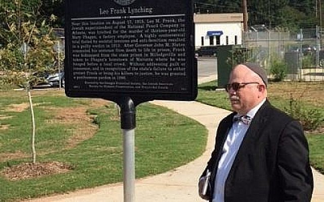 Rabbi Steve Lebow alongside the sign commemorating the Leo Frank Lynching.