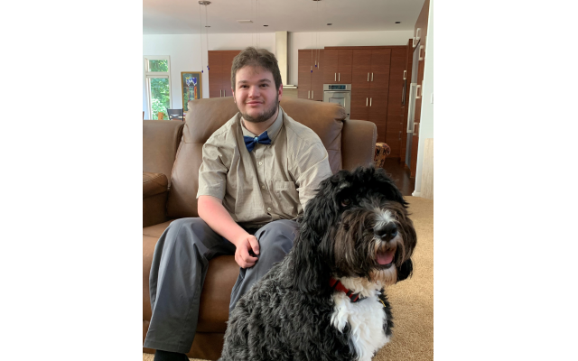 Drew Shulman relaxes with dog Juno. He is a student in the Georgia Tech Excel Program entering his fourth and final year.