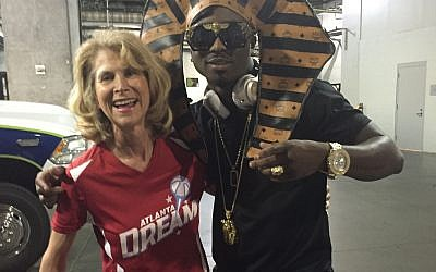 Backstage with a rapper at the former Philips Arena, now State Farm Arena, before cheerleading with the senior WNBA Dream Supremes, which she co-founded.