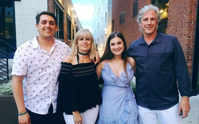 Chloe (second from right) enjoys spending time with her family: Graham, Robyn Rousso, and Tony Levitas.