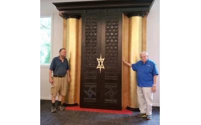 Jonathan Alexander helped Israel Peljovich restore the ark doors.