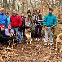 Temple Kol Emeth Hiking Group, the TKE Trekkers, along with their dogs. Bottom row: Eli Goodstein, Nikki Goodstein, Tovi, Bo and Nachas. Top row: Michael Dresden, Alison Schlenger, Roger Goodstein, Serena Sacks, Lauren Parker, Jay Bauer, Karyn Parker and Hal Schlenger.