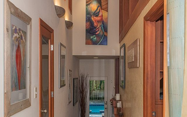The spa sauna entrance features their daughter's portrait by San Francisco artist Regina Hunt.