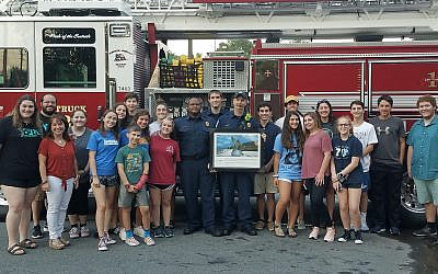 JNF and Etz Chaim's USY remember 9/11 and present Cobb firefighters with a framed image of Israel's 9/11 Living Memorial in Jerusalem.
