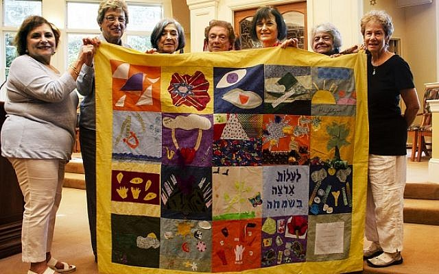 Photo courtesy of Temple Sinai, N.J. // The creators of the quilt are happy to have it back in New Jersey. From left: Judi Kietz, Beverly Brodsky, Lois Steinberg, Helen Friedman, Linda Barr, Barbara Gross and Jean Goldstein.