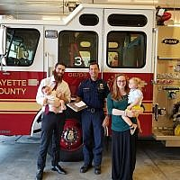 Chabad Rabbi Avrohom Chayempour and his family from Tyrone in South Georgia brought brownies to their local Fayette County fire department.