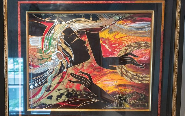 This hand-applied metallic work by M. Martiros showcases an example of Scott's creative framing.