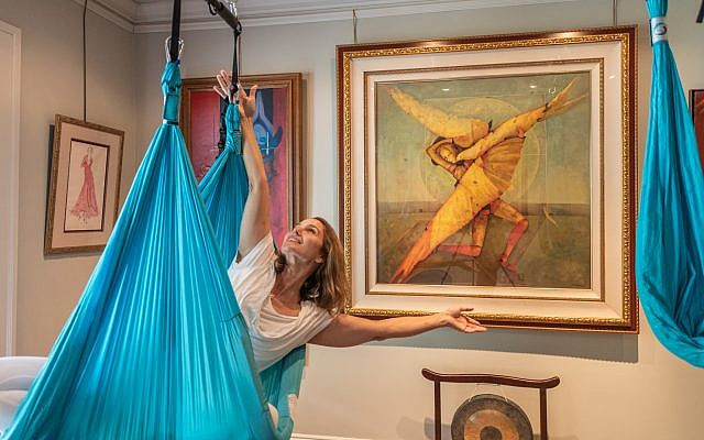 In the home studio,  Krista flowingly echoes the positioning of the silk screen serigraph by Russian artist Mihail Aleksandrov with her aerial yoga pose.