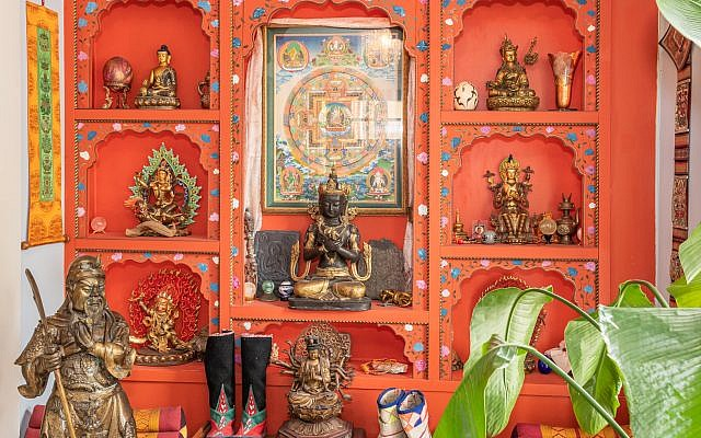 Scott constructed this entire wall for his Tibetan art collection. His mother was co-owner of a trekking agency to exotic locations.