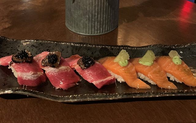 """""""Over the top"""" taste on this dish: Blue fin tuna topped with black truffles and caviar, left, and wasabi salmon with citrus and green tea salt, right."""