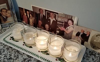 Flora Rosefsky remembers departed loved ones at Yom Kippur with photos in addition to yahrzeit candles.