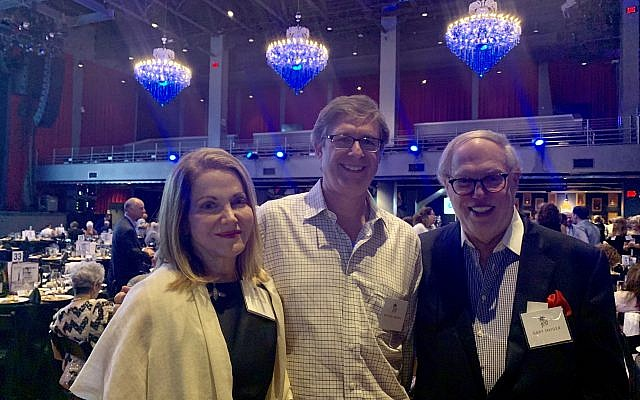 Ellen Monk and Gary Snyder (Greenberg Traurig) flank Michael Morris, publisher of the Atlanta Jewish Times.