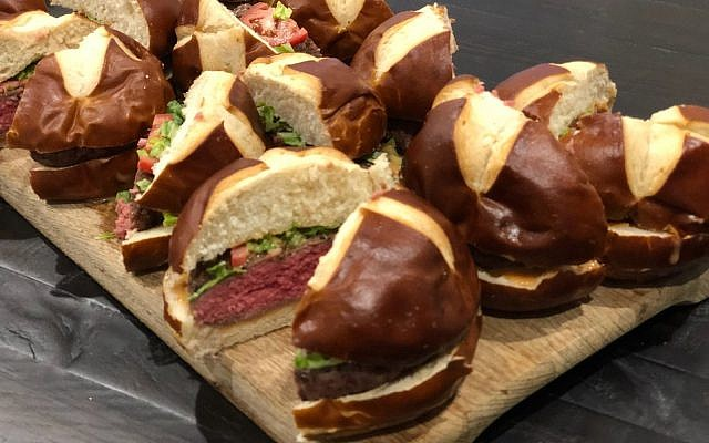 EB Catering is known for its bar food like these burgers in pretzel buns with arugula, onion jam and garlic.