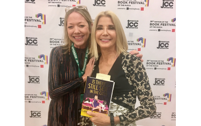 "Evans poses with author Candace Bushnell. Evans is a huge fan of the ""Sex in the City"" series."