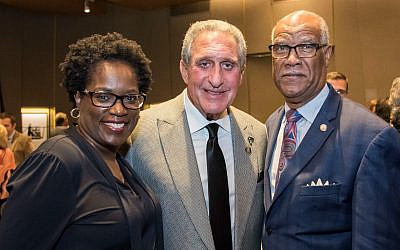 Arthur Blank, center, honored at the Torch of Liberty awards dinner, is pictured here with Antoinette Tuff and Rep. Calvin Smyre.