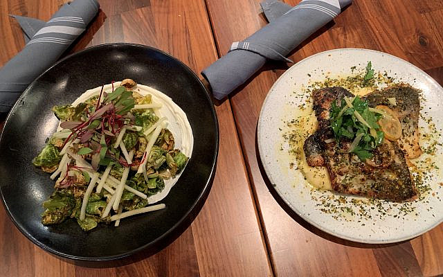 Charred Brussels sprouts salad over goat cheese with matchstick apple slices (top) pairs well with branzino with preserved lemon over polenta.