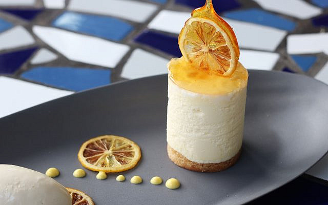 Photo courtesy of Kyma // Lemon manouri cheesecake with saffron yogurt emulsion.