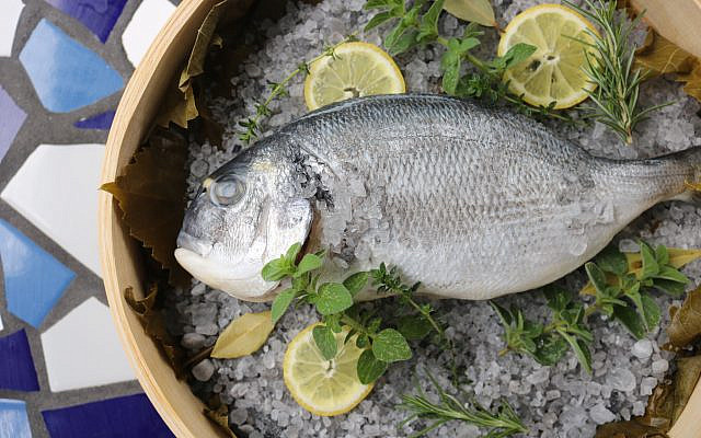 The tsipoura fish imported from Greece is full-flavored, semi firm and flaky. Many like the authentic portion with the head en plate.