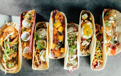 Photo by Velvet Taco // A multi-cultural, globe-trotting row of tacos all made from scratch in-house.