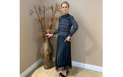 Local Fox's manager Rita Batens De Vuyst shows a blue sweater by Yal ($59) and skirt by Wish by Anjie ($39) from the modest European collection.