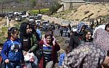 Photograph: George Ourfalian/AFP/Getty // Civilians flee the city of Afrin in northern Syria on March 16th, 2018. A Turkish-led offensive to capture the Kurdish-majority enclave has forced 30,000 civilians from its main city in 24 hours.