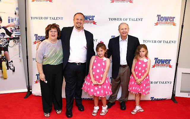 Photo by Travis Hudgons // Sponsor Michael Greenbaum, second from right, with wife Anne, left, son David, and twin granddaughters.