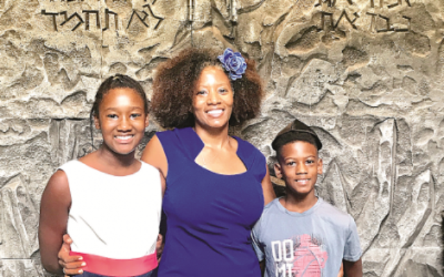 Tarece Johnson, center, and her children, Hannah and Nile, show diversity in the Atlanta Jewish community.