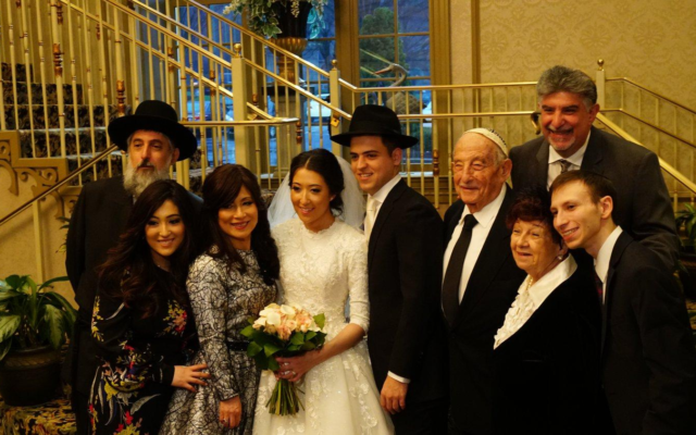 """Horvath-Kosman wedding: Dad Stephen """"Tzvi"""" Horvath; Yael Gutman, sister of the bride; mom Junko """"Rivka"""" Horvath; bride Adina Kosman; groom Lozzi Kosman; Avraham """"Al"""" Horvath (z""""l ); Claire Horvath; Meir Yaakov Gutman; and Marc Horvath, top right."""