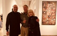"Gallery owner Bill Lowe welcomes Steve Human and Joanne Ackerman alongside ""Pure American."" Taupin's 2017 work was made from flag material and is priced at $28,500."