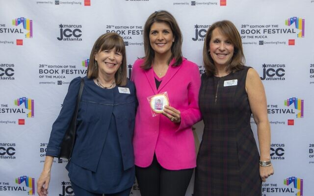 Book Festival co-chairs Susie Hyman and Deena Profis with Nikki Haley, center.