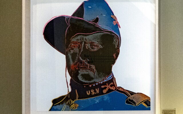 """Andy Warhol's 1986 """"Teddy Roosevelt"""" screen print sits above a letter from Franklin Delano Roosevelt to then Georgia Gov. Ellis Arnall."""