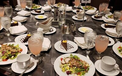 Photo by Martha Jo Katz // The pink theme was colorfully carried through the Crowne Plaza Ravinia ballroom with table settings for more than 350.