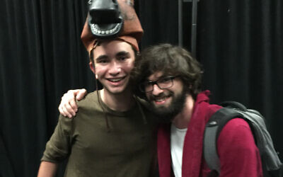 "Riverwood International Charter School senior Josh Lerner, left, celebrates the opening of ""Agni Kai,"" an original student-written, directed, and run play, with its creator, senior Shane Kleber."
