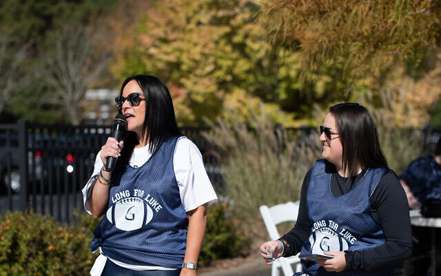 Photo by Eddie Samuels // Sandi and Sophie Greenfield spoke, thanking those in attendance and spreading awareness of autism.
