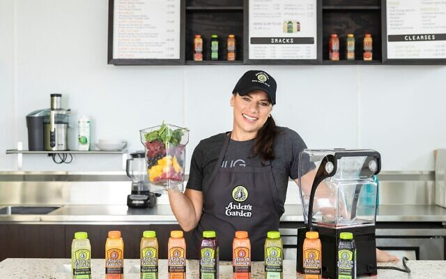 Leslie Zinn shows off the store's products: juices and smoothies.
