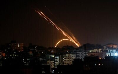 Anas Baba / AFP // Rockets are fired from the Gaza Strip toward Israel Nov. 13.