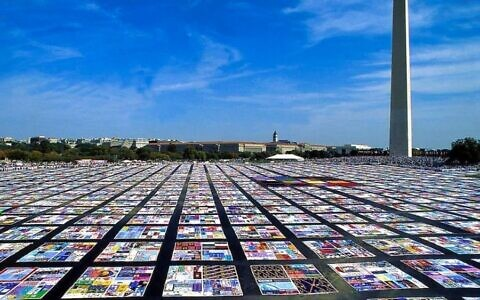 The quilt has some 50,000 panels sewn into 12-by-12-foot blocks bearing the names of more than 105,000 people that when spread out would span more than 1.3 million square feet.