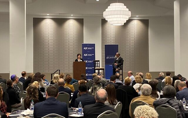 "Photo by American Jewish Committee // Rabbi Ellen Nemhauser addresses event to mark the 54th anniversary of the groundbreaking ""Nostra Aetate."" Seated to her left is Brendan Murphy, who teaches history at the Marist School and also spoke."