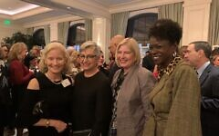 Honoree Carol B. Tomé, second from left, is flanked by Liz Blake and Lee Zack, president of Agnes Scott College, and Danita Knight, vice president of communications for the college.