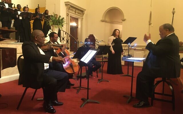 The performance was prepared and conducted by Curtis Everett Powell with guest soloist Elizabeth Birger.