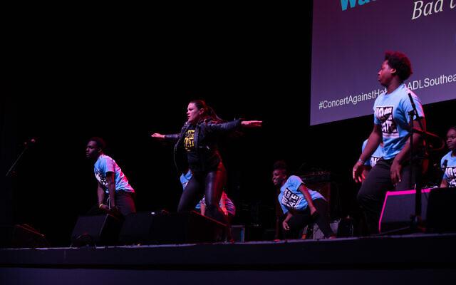 Dr. Meria Carstarphen kicks off Bad to the Bone's dance routine.