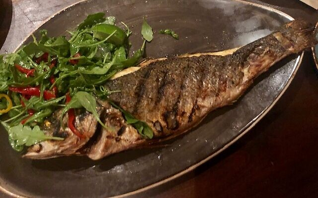 Whole roasted fish with dressed greens was grilled to perfection.