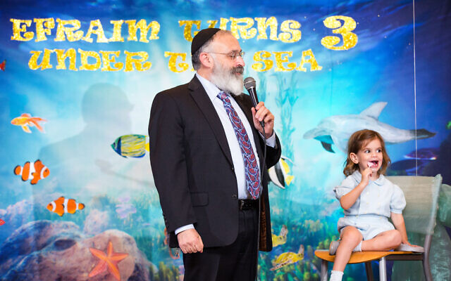 Photo by Sarah Slavik Photography // Proud grandfather Rabbi Yossi New wishes Efraim a life of success without compromising his values.