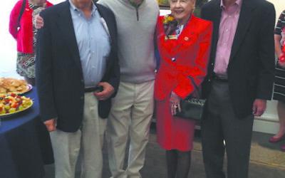 Helen Regenstein, in red, celebrates her 101st birthday with her family, son Reg, far left, grandson Dan, and son Kent, far right.