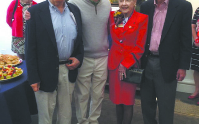 Helen Regenstein, in red, celebrates her 101st birthday with her family, son Reg, far left, grandson Dan, and son Kent, far right.