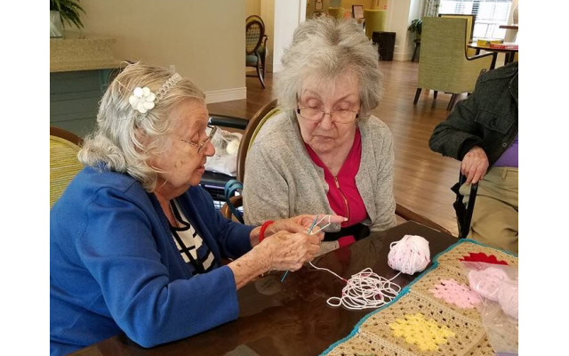 Resident-led activities at Berman Commons, such as the Crochet Club, provide meaningful engagement for residents to learn new skills in a social environment.