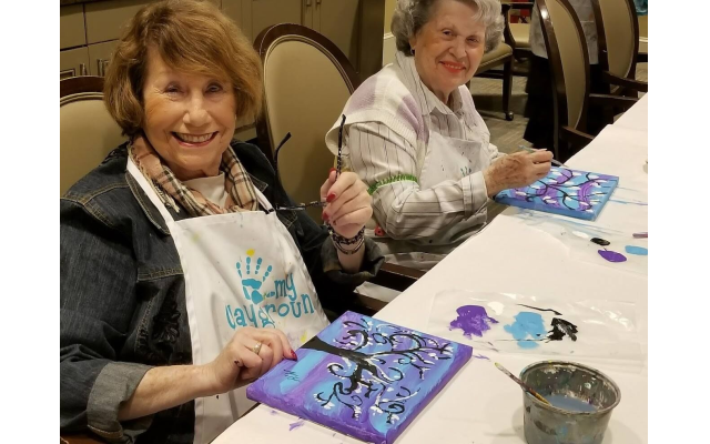 Art classes and other social activities in assisted living communities help reduce feelings of loneliness and isolation.